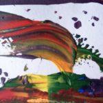 Bunte Farbkleckse in Form eines Drachen.